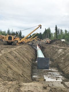 Installing pipe at a road crossing on CGL right-of-way