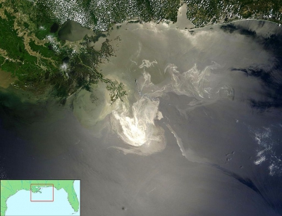 NASA image taken from its Terra Satellite on May 24, 2010 of the oil slick from the Macondo explosion and fire illuminated by sunlight (Photo credit: NASA)